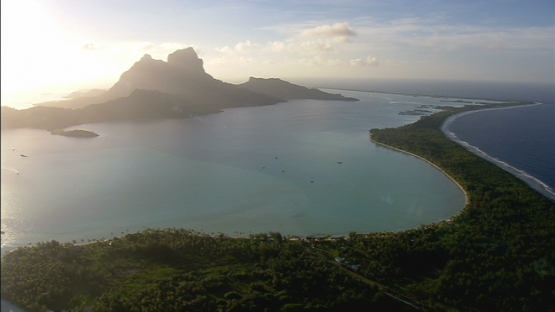 Bora Bora aerial view at sunset, leeward islands, mountain and lagoon
