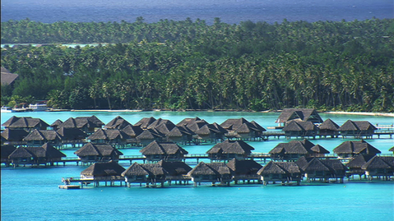 Aerial view of a luxury hotel and overwater bungalows in the lagoon of Bora Bora, Leeward islands