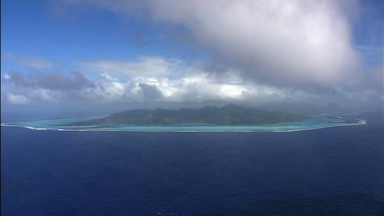 Huahine, Leeward islands, aerial view of the island under the clouds