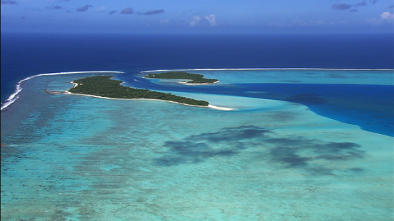Maupiti, Leeward islands, aerial view of the barrier reef and the pass