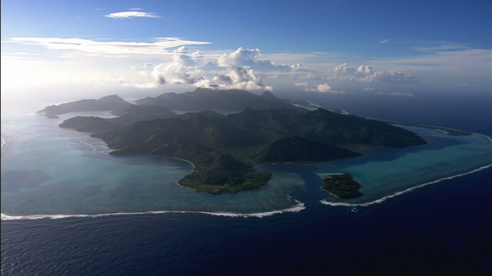 Huahine, Leeward islands, aerial view of the island and barrier reef
