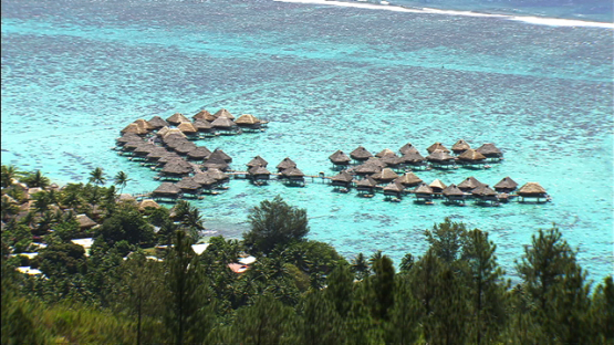 Moorea aerial view of hotel and overwater bungalows in the lagoon, windward islands
