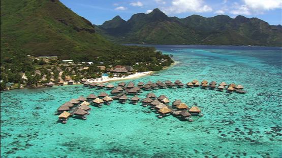 Moorea aerial view of luxury hotel and overwater bungalows in the lagoon, windward islands