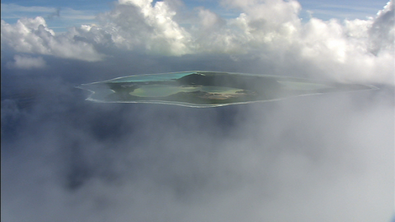 Aerial view of Maiao hidden by clouds, windward islands