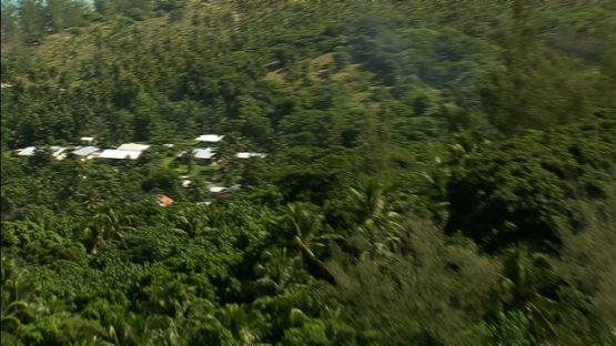Maiao over the hill, finding the village, aerial view, windward islands