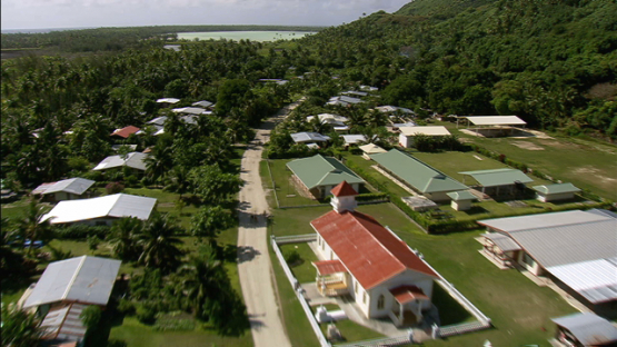 Maiao, aerial view of the village, church and street, windward islands
