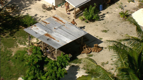 Maiao, aerial view of people working with pandanus bundles, windward islands