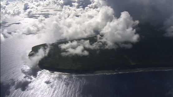 Aerial view of Makatea behind the clouds, tuamotu archipelago