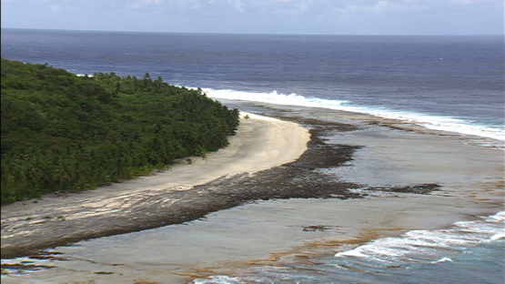Aerial view of a white sand beach of Makatea, tuamotu archipelago