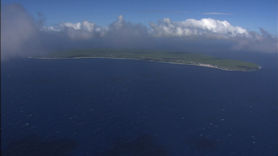 Aerial view of the island Makatea from the ocean, Tuamotu islands