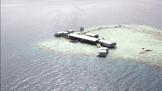 Ahe, aerial view of a large pearl farm on the lagoon, Tuamotu archipelago