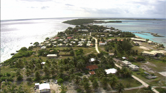 Manihi, aerial view of the village Turipaoa betwenn ocean and lagoon, Tuamotu archipelago