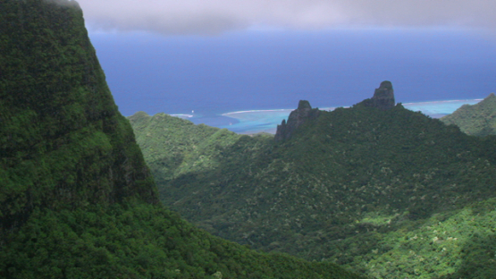 Moorea, aerial view of the rocky mountains and ocean, windward islands, 4K UHD