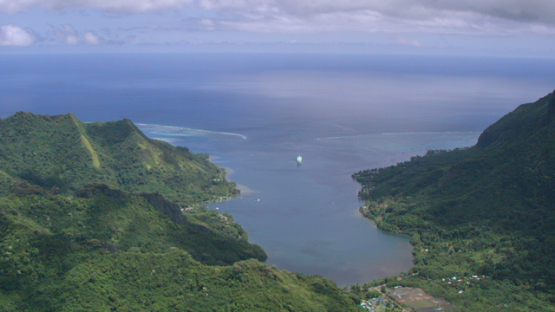 Moorea, aerial view of a cruise ship in Opunohu Bay, windward islands, 4K UHD