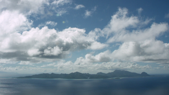 Aerial view of Huahine, Leeward islands, under the clouds, 4K UHD