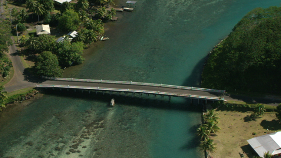 Aerial view of Huahine, Leeward islands, bridge between islands in the lagoon, 4K UHD