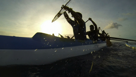 Tahiti, tahitian canoe and paddlers training in the lagoon, over the camera
