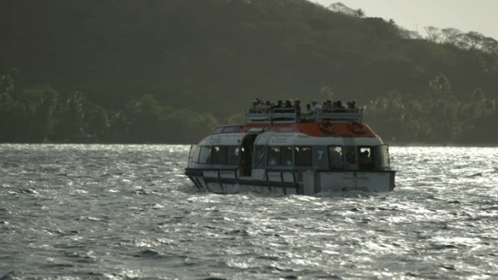 Passengers on motor boat sailing to the cruise ship, Bora Bora