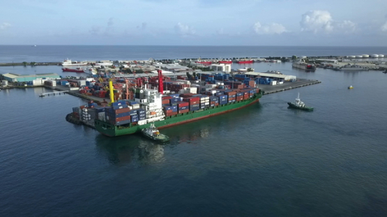 Tahiti,  aerial video drone of cargo ship in the harbour of Papeete
