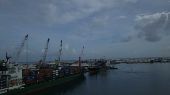 Tahiti, aerial video drone of cargo ships in the harbour of Papeete