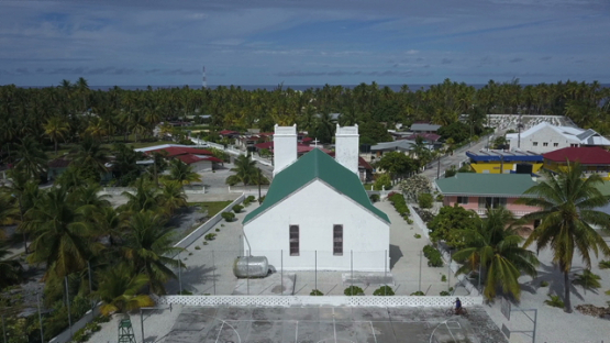 Reao, aerial drone shot above the church of the village, Tuamotu, Polynesia 4K UHD