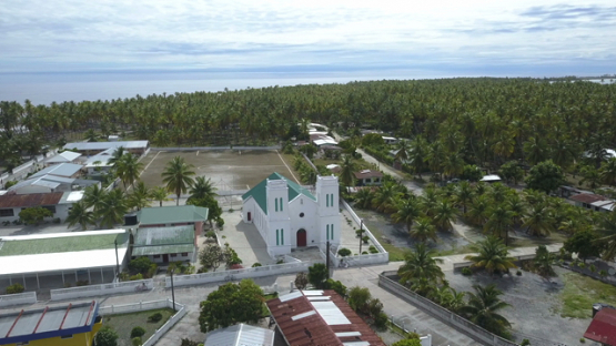 Reao, aerial drone shot of the church of the village, Tuamotu, Polynesia 4K UHD