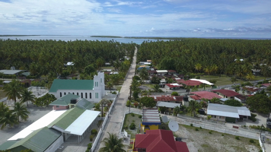 Reao, aerial drone shot  of the village and church, Tuamotu 4K UHD
