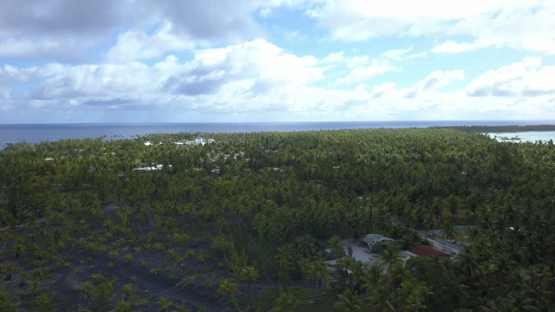 Reao, aerial drone view of the island and village, Tuamotu, Polynesia, 4K UHD