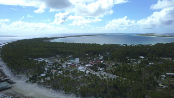 Reao, aerial view by drone of the village and lagoon, tuamotu, polynesia,  4K UHD