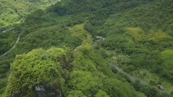 Tahiti, aerial drone video of Fare Hape of rocky crest and river maroto, Papeno valley, french Polynesia