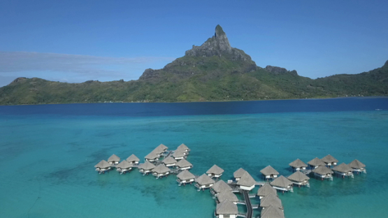 Bora Bora, aerial drone video of a luxury overwater hotel in the lagoon, leeward islands, polynesia