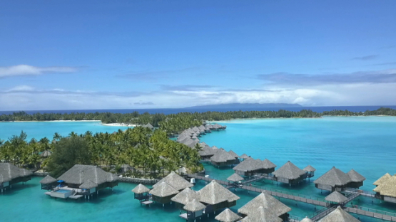 Bora Bora, aerial drone video of luxury overwater hotel in the lagoon, leeward island, polynesia