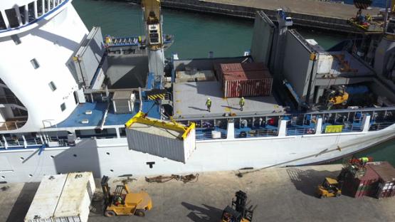 Ua Pou, aerial drone video of cargo ship unloading goods on the dock, marquesas islands, polynesia, 4K UHD
