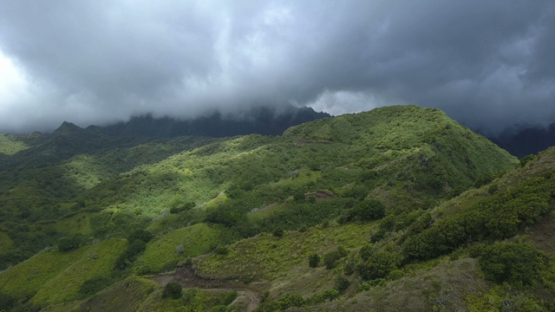 Fatu Hiva, aerial drone video of the mountains and valley under clouds, marquesas islands, Polynesia 4K UHD