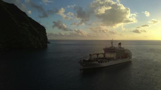 Fatu Hiva sunset, aerial drone video of cruise ship anchored in the Virgins bay, Marquesas islands, Polynesia, 4K UHD