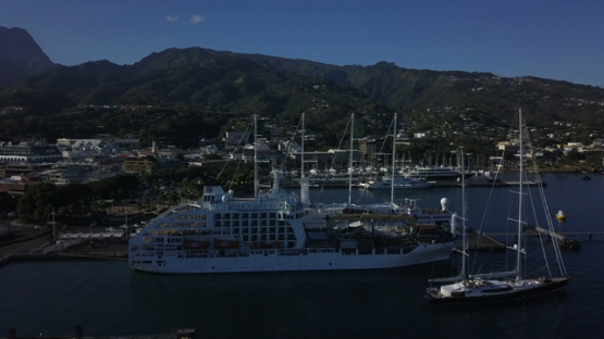 Papeete harbour, aerial drone video of cruise ship moored, Tahiti, Polynesia, 4K UHD
