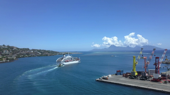 Papeete, aerial drone video of a cruise ship in the bay, Tahiti, Polynesia 4K UHD