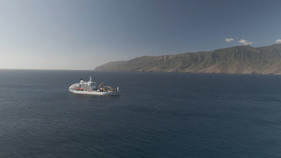 Aerial drone view, Cargo cruise ship moored in the bay, Marquesas islands, Polynesia, 2K7