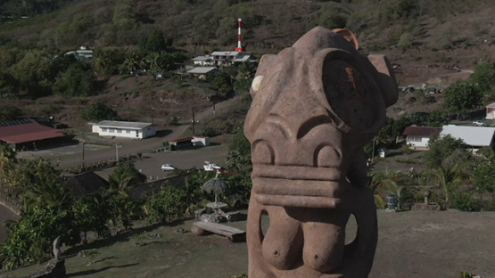 Aerial drone video of giant tiki in the bay of Taiohae, Nuku Hiva, marquesas islands, 2K7