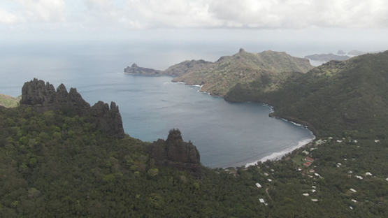 Aerial drone video, Nuku Hiva, bay of Hatiheu, rocky mountains, marquesas islands, 2K7