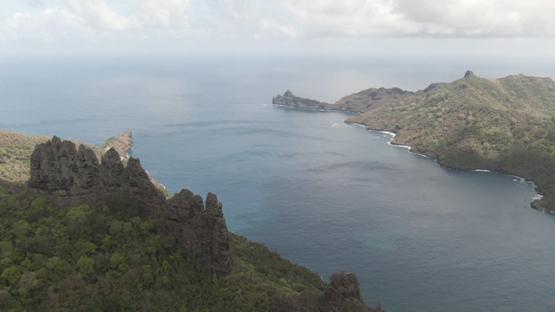Aerial drone video, Nuku Hiva, bay of Hatiheu, rocky mountains, marquesas islands, 2K7