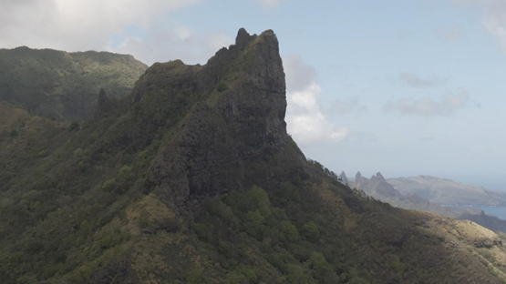 Aerial drone video, Nuku Hiva, mountains of Hatiheu and Aakapa, rocky mountains, marquesas islands, 2K7