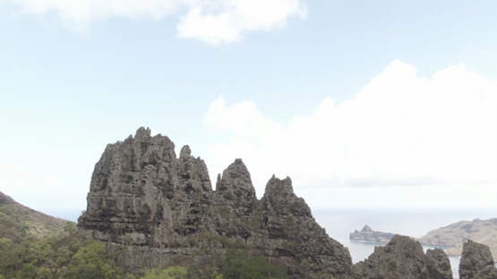 Aerial drone video, Nuku Hiva, valley and bay of Hatiheu, rocky mountains, marquesas islands, 2K7