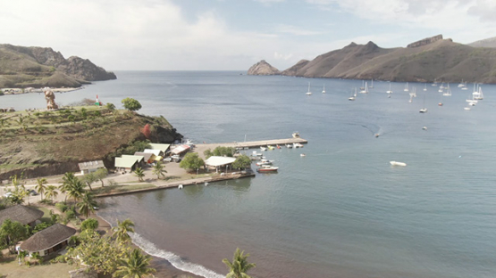 Aerial drone video of Nuku Hiva, bay of Taiohae and sail boat anchored, marquesas islands, 2K7
