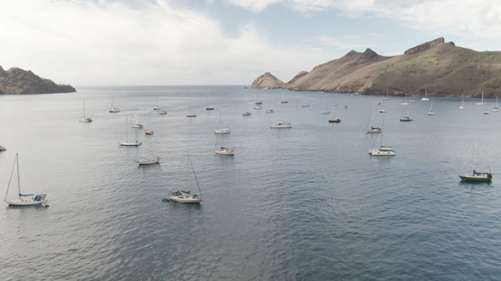 Aerial drone video of Nuku Hiva, sail boats in Taiohae bay, marquesas islands, 2K7