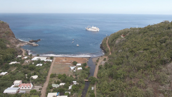 Fatu Hiva, aerial drone view of villlage Omoa and cargo ship in the bay, marquesas islands, 2K7