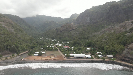 Fatu Hiva, aerial drone view of villlage Omoa and mountains surrounding, marquesas islands, 2K7