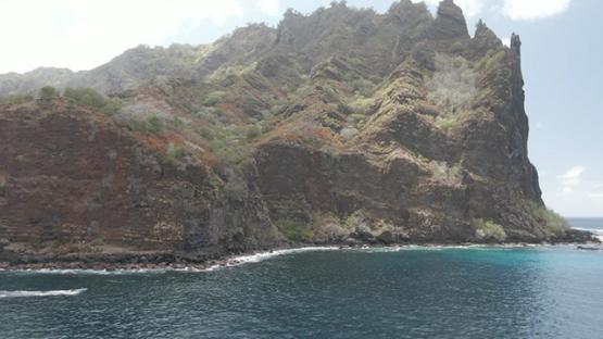 Fatu Hiva, aerial drone view of little boat near a mountain of marquesas islands, 2K7