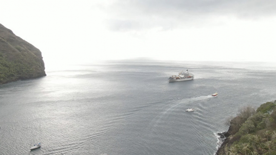 Aerial drone view of Fatu Hiva, cargo ship in the bay, Marquesas islands, Polynesia, 2K7