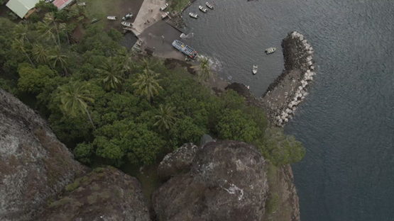 Aerial drone view of Fatu Hiva, above the rocks and pier, Marquesas islands, Polynesia, 2K7